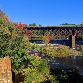 Created by you Beautiful contrast early fall foliage, by a train trestle over the Salmon Falls / Beautiful contrast early fall foliage, by a train trestle over the Salmon Falls River in NH.