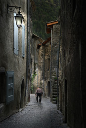 Evening walk / An old man making his evening walk in the narrow streets of Chatillon-en-Diois / France.