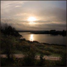 Lone rybachok on the river ..... / ***